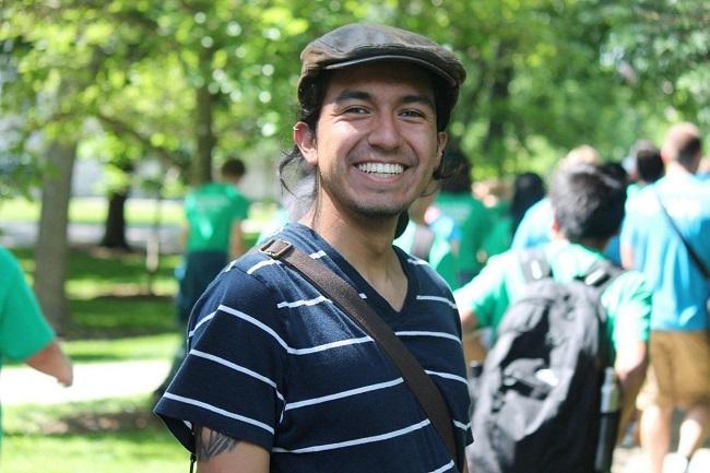 Photo of Benji smiling outdoors